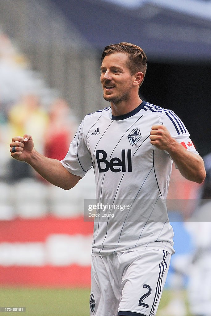 Jordan Harvey #2 of the Vancouver Whitecaps celebrates the Whitecaps' second goal against Chicago Fire scored by teammate Camilo Sanvezzo #7 (not pictured) during an MLS Match at B.C. Place on July 14, 2013 in Vancouver, British Columbia, Canada. The Vancouver Whitecaps won 3-1.