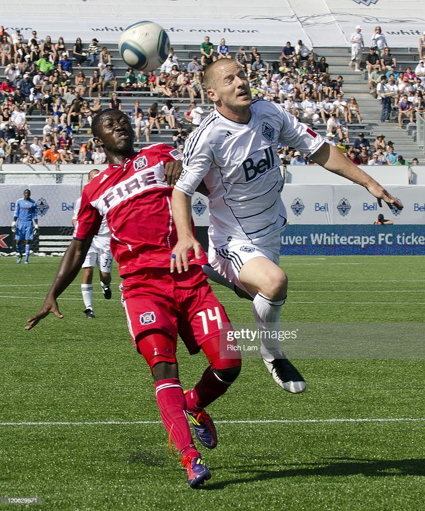 Jordan Harvey #26 of the Whitecaps FC battles with Patrick Nyarko #14 of the Chicago Fire during the first half of MLS Soccer on August 07, 2011 at Empire Field in Vancouver, BC, Canada.