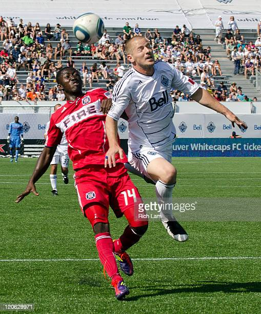 Jordan Harvey of the Whitecaps FC battles with Patrick Nyarko of the Chicago Fire during the first half of MLS Soccer on August 07 2011 at Empire...