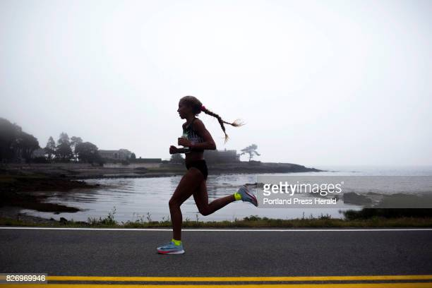 Jordan Hasay is silhouetted against a foggy Pond Cove as she nears the five mile marker during the 20th annual TD Beach to Beacon 10K