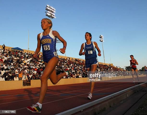 Jordan Hasay of San Luis Obispo Mission Prep leads Laurynne Chetelat of Davis in the girls' 3200 meters in the CIF State Track Field Championships at...