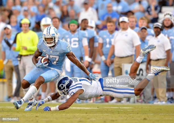 Jordan Hayes of the Duke Blue Devils dives to tackle Anthony RatliffWilliams of the North Carolina Tar Heels during their game at Kenan Stadium on...