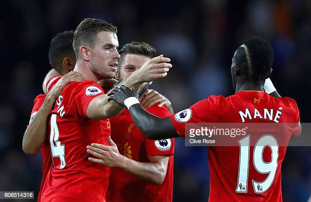 Jordan Henderson Adam Lallana and Sadio Mane of Liverpool celebrate victory in the Premier League match between Chelsea and Liverpool at Stamford...
