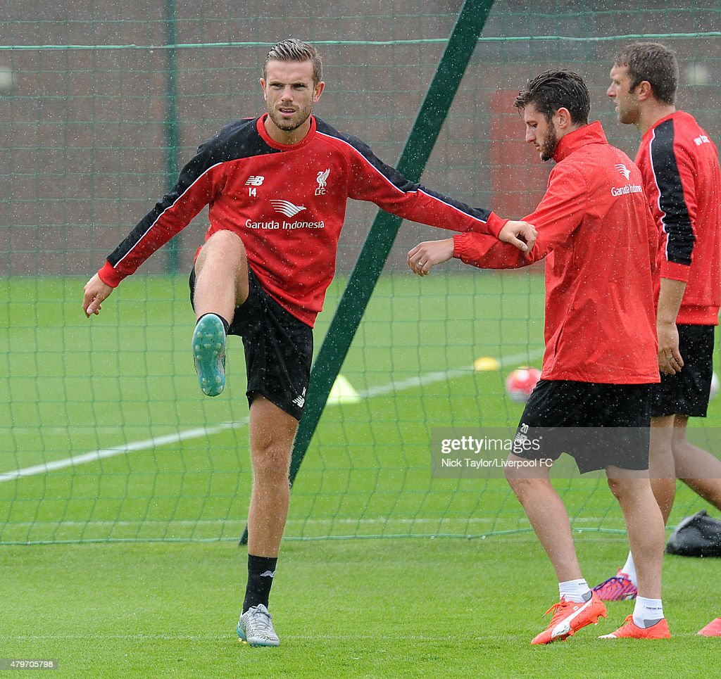 Jordan Henderson and Adam Lallana warm up as Liverpool players return for pre-season training at Melwood Training Ground on July 6, 2015 in Liverpool, England.