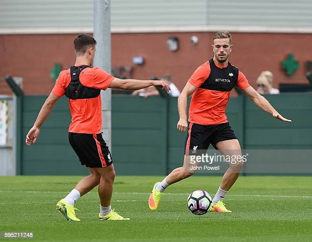 Jordan Henderson and Cameron Brannagan of Liverpool during a training session at Melwood Training Ground on August 25 2016 in Liverpool England