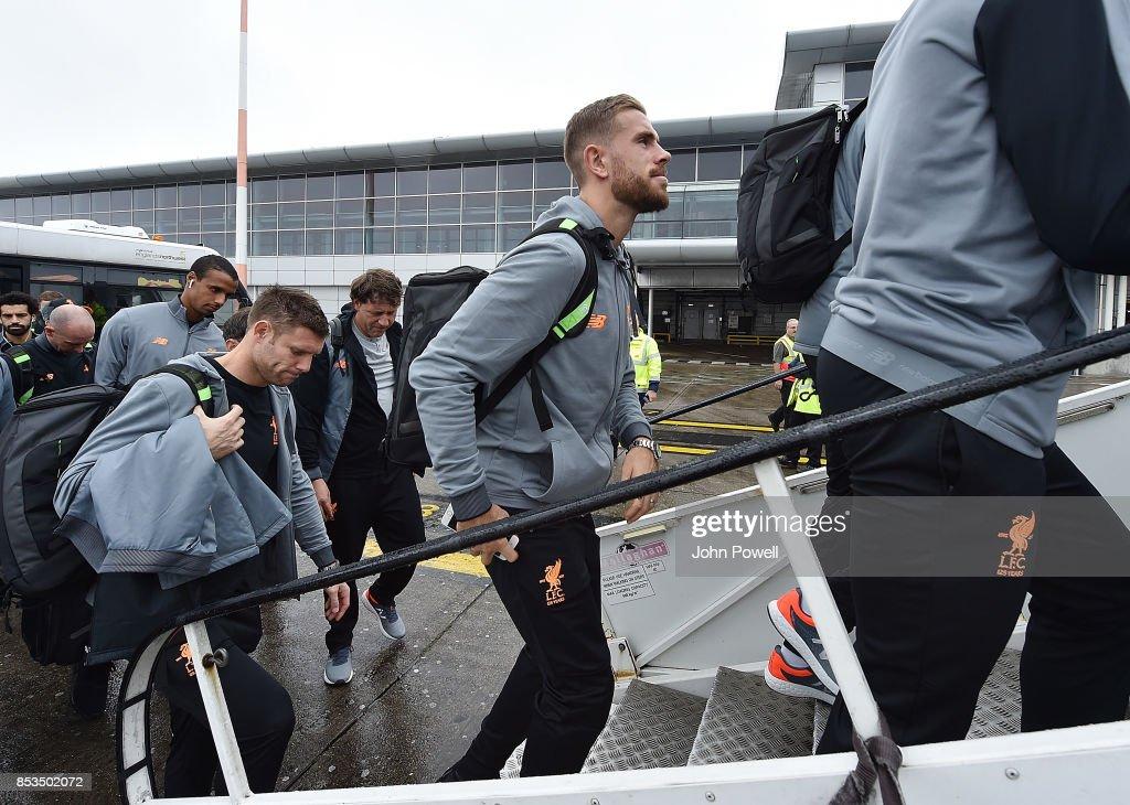 Jordan Henderson and James Milner of Liverpool boarding the plane at John Lennon Airport on September 25, 2017 in Liverpool, England.