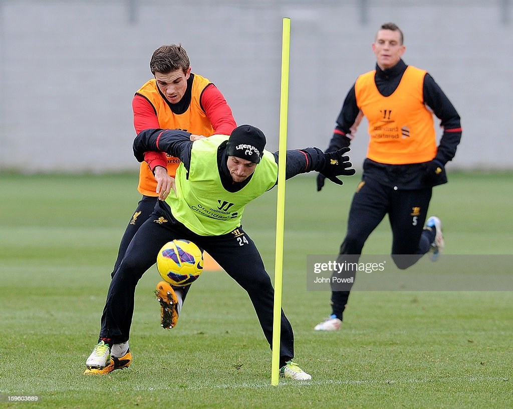 <a gi-track='captionPersonalityLinkClicked' href=/galleries/search?phrase=Jordan+Henderson&family=editorial&specificpeople=4940390 ng-click='$event.stopPropagation()'>Jordan Henderson</a> and Joe Allen of Liverpool in action during a training session at Melwood Training Ground on January 17, 2013 in Liverpool, England.