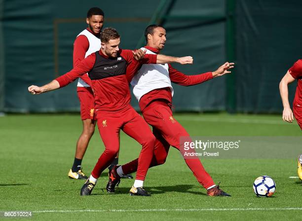 Jordan Henderson and Joel Matip of Liverpool during a training session at Melwood Training Ground on October 12 2017 in Liverpool England