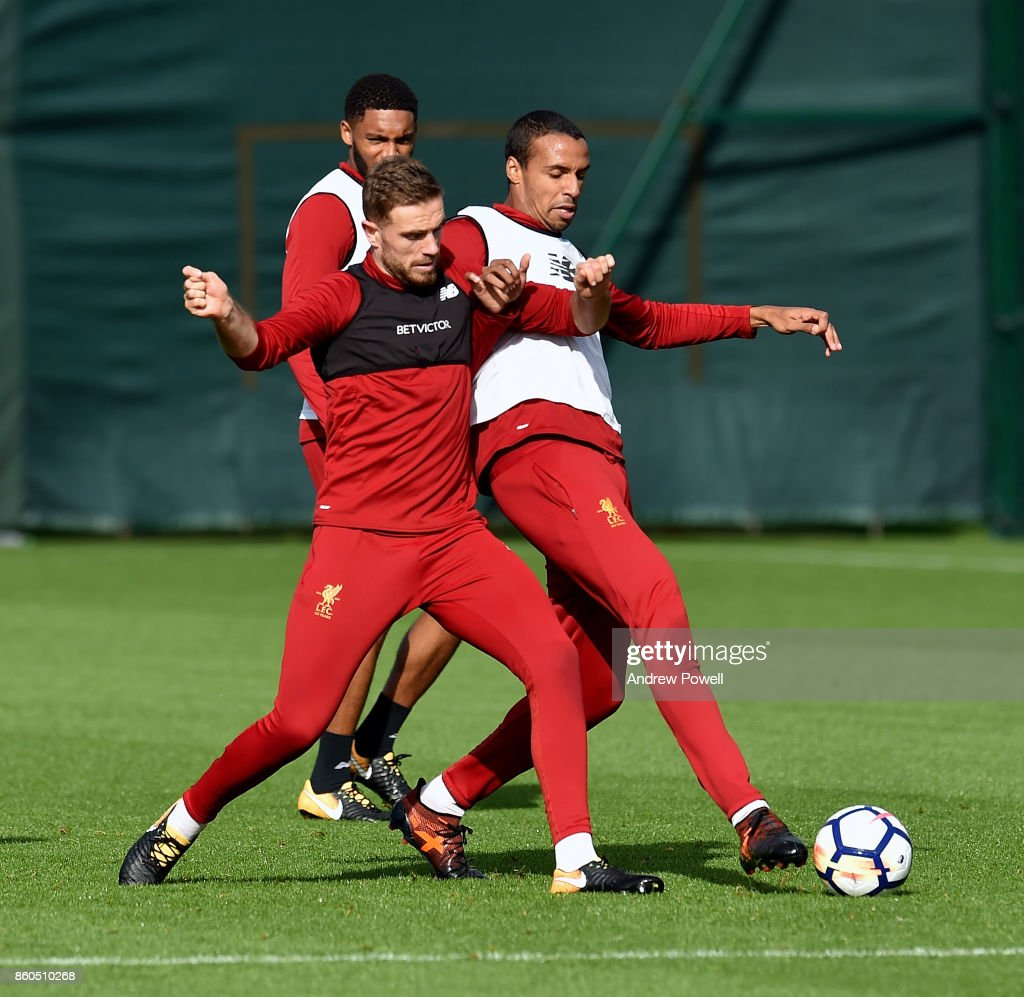Jordan Henderson and Joel Matip of Liverpool during a training session at Melwood Training Ground on October 12, 2017 in Liverpool, England.