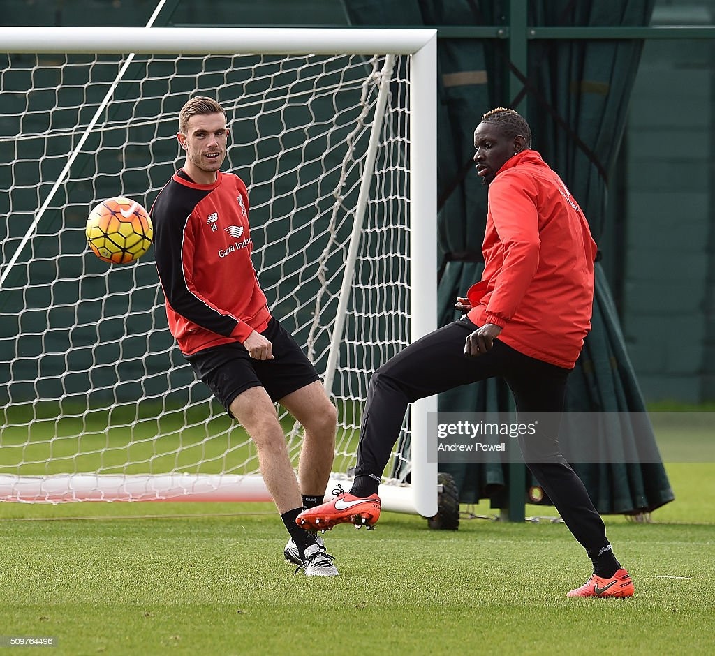 <a gi-track='captionPersonalityLinkClicked' href=/galleries/search?phrase=Jordan+Henderson&family=editorial&specificpeople=4940390 ng-click='$event.stopPropagation()'>Jordan Henderson</a> and <a gi-track='captionPersonalityLinkClicked' href=/galleries/search?phrase=Mamadou+Sakho&family=editorial&specificpeople=4154099 ng-click='$event.stopPropagation()'>Mamadou Sakho</a> of Liverpool during a training session at Melwood Training Ground on February 12, 2016 in Liverpool, England.