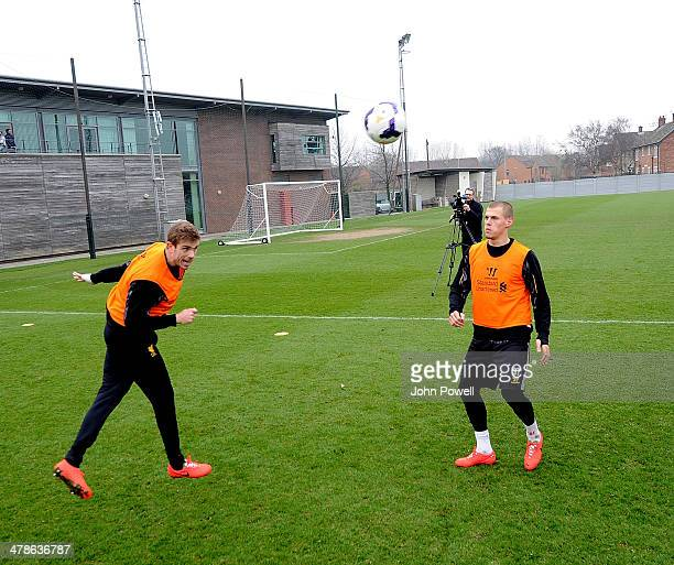 Jordan Henderson and Martin Skrtel of Liverpool in action during a training session at Melwood Training Ground on March 14 2014 in Liverpool England