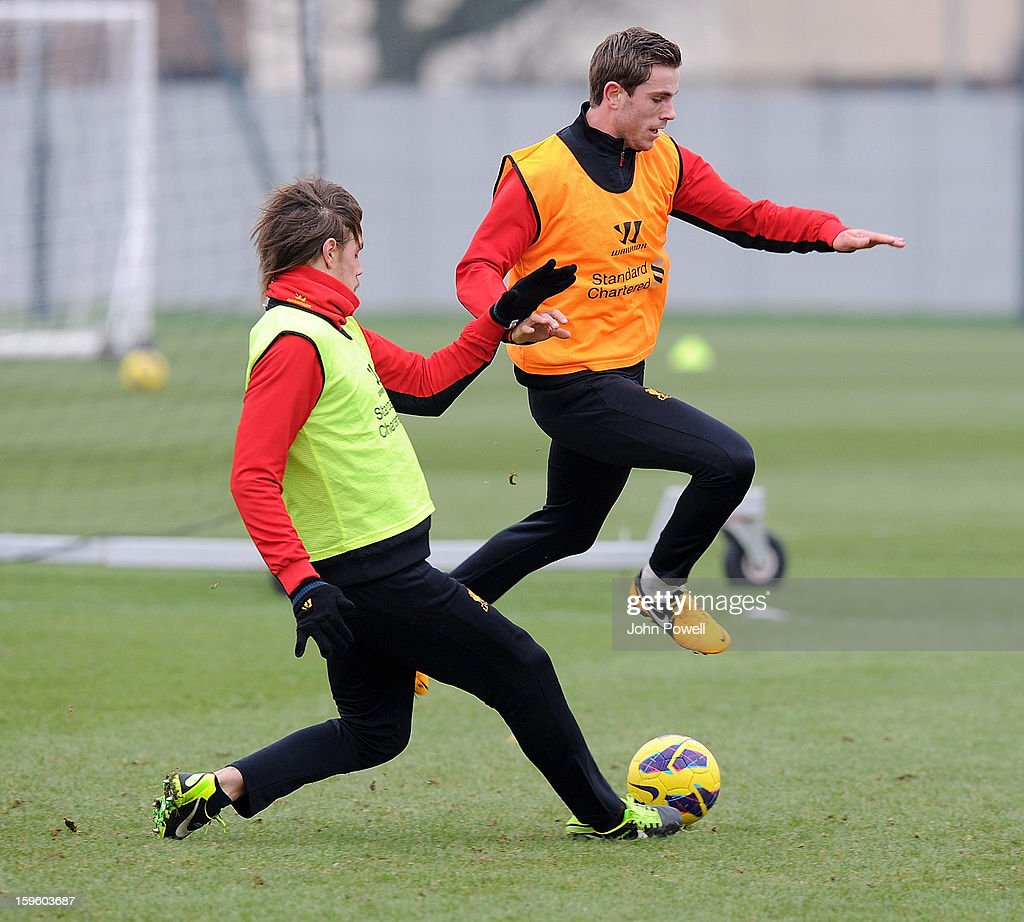 Jordan Henderson and Sebastian Coates of Liverpool in action during a training session at Melwood Training Ground on January 17, 2013 in Liverpool, England.