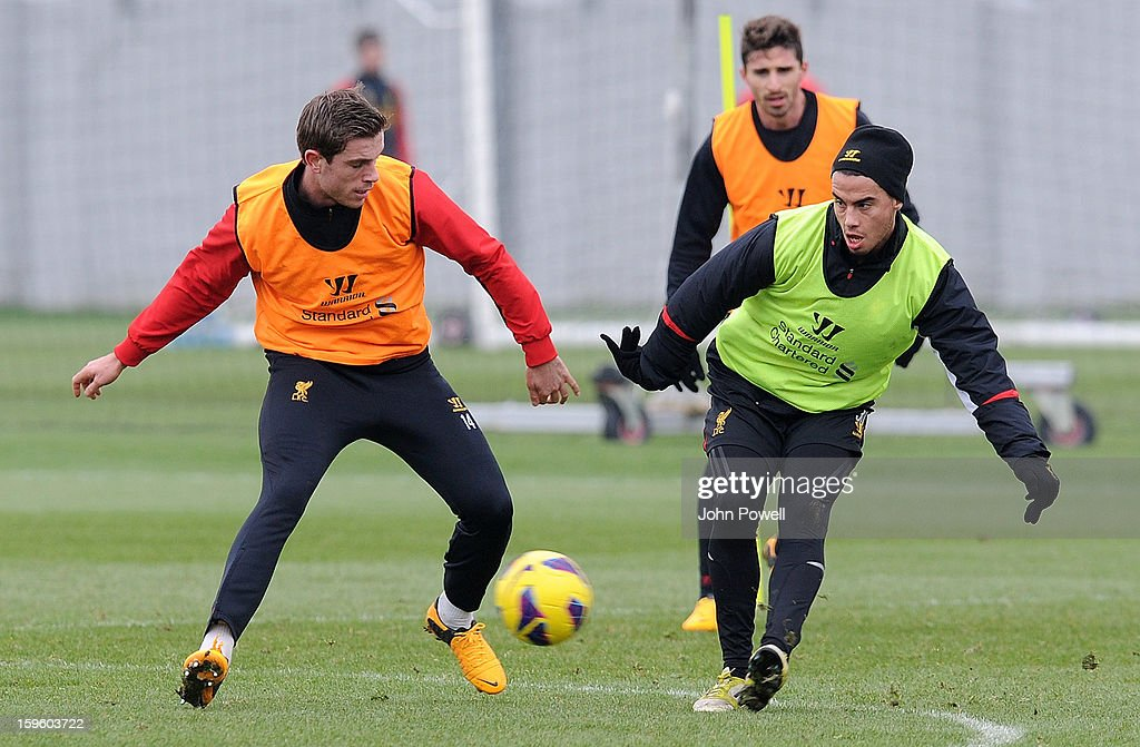Jordan Henderson and Suso of Liverpool in action during a training session at Melwood Training Ground on January 17, 2013 in Liverpool, England.