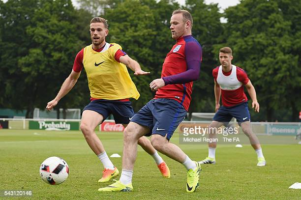 Jordan Henderson and Wayne Rooney in action during the England training session on June 26 2016 in Chantilly France