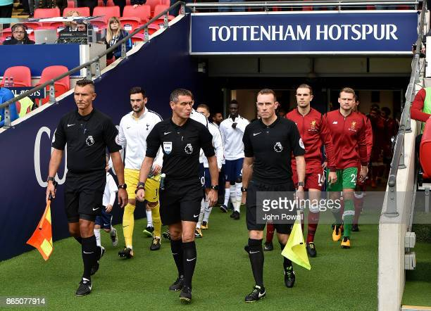 Jordan Henderson captain of Liverpool leads his team out with Hugo Lloris captain of Tottenham Hotspur during the Premier League match between...