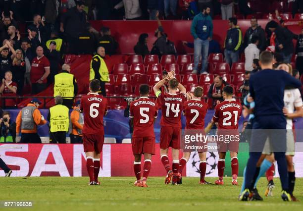 Jordan Henderson Georginio Wijnaldum James Milner Dejan Lovren and Alex OxladeChamberlain of Liverpool shows his appreciation to the fans at the end...