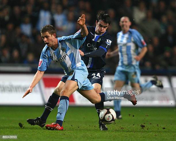 Jordan Henderson of Coventry City is challenged by Keith Treacy of Blackburn during the FA Cup 5th Round Replay match sponsored by eon between...