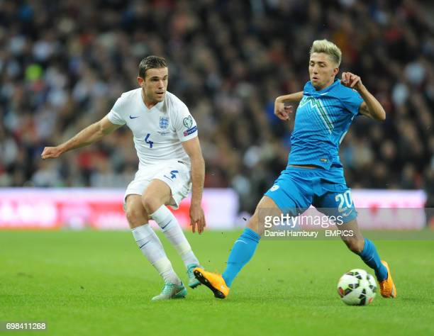 Jordan Henderson of England and Kevin Kampl of Slovenia battle for the ball