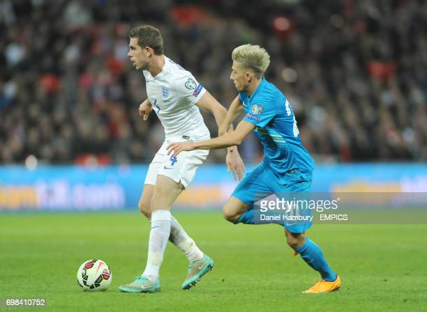 Jordan Henderson of England holds off Kevin Kampl of Slovenia