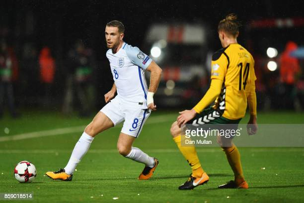 Jordan Henderson of England is faced by Vykintas Slivka of Lithuania during the FIFA 2018 World Cup Group F Qualifier between Lithuania and England...