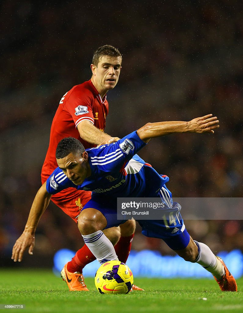 <a gi-track='captionPersonalityLinkClicked' href=/galleries/search?phrase=Jordan+Henderson&family=editorial&specificpeople=4940390 ng-click='$event.stopPropagation()'>Jordan Henderson</a> of Liverpool and Jake Livermore of Hull City battle for the ball during the Barclays Premier League match between Liverpool and Hull City at Anfield on January 1, 2014 in Liverpool, England.