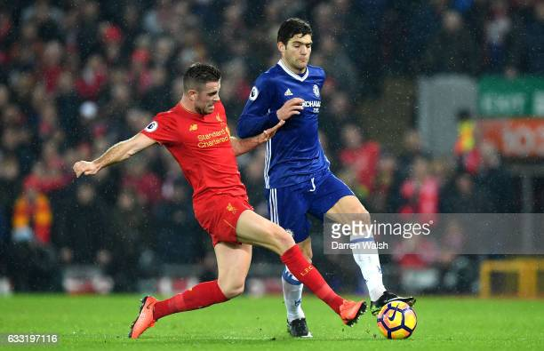 Jordan Henderson of Liverpool and Marcos Alonso of Chelsea compete for the ball during the Premier League match between Liverpool and Chelsea at...