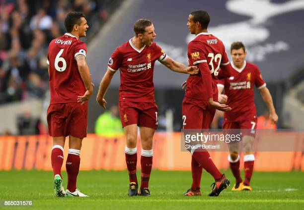 Jordan Henderson of Liverpool argues with Dejan Lovren of Liverpool and Joel Matip of Liverpool during the Premier League match between Tottenham...