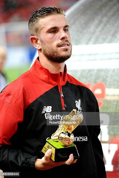 Jordan Henderson of Liverpool brings the gold shoes trophy during the international friendly match between Thai Premier League All Stars and...