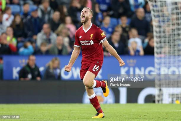Jordan Henderson of Liverpool celebrates after putting Liverpool 31 ahead during the Premier League match between Leicester City and Liverpool at The...