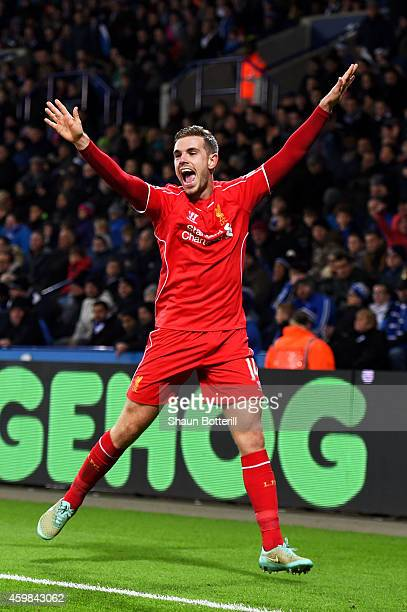 Jordan Henderson of Liverpool celebrates after scoring his team's third goal during the Barclays Premier League match between Leicester City and...