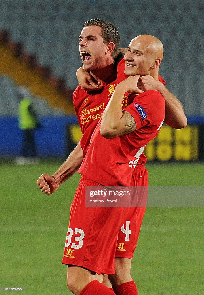 Jordan Henderson of Liverpool celebrates after scoring the opening goal during the UEFA Europa League Group A match between Udinese Calcio and...