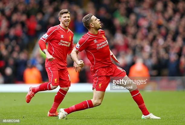 Jordan Henderson of Liverpool celebrates after scoring the opening goal during the Barclays Premier League match between Liverpool and Manchester...