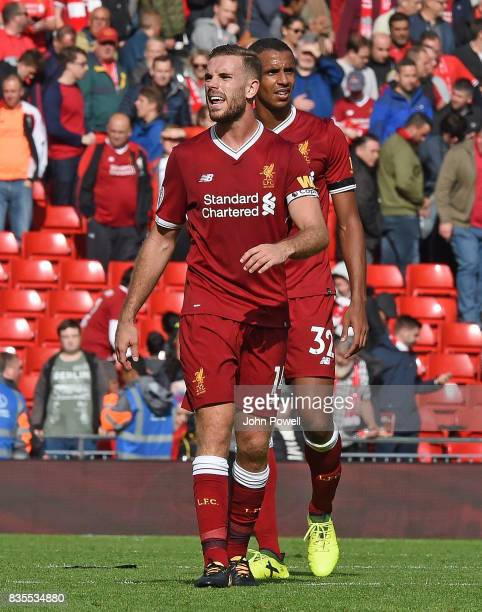 JOrdan Henderson of Liverpool celebrates at the end of the Premier League match between Liverpool and Crystal Palace at Anfield on August 19 2017 in...