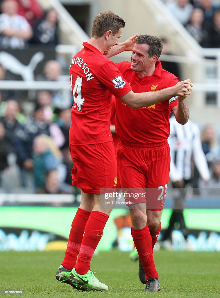 Jordan Henderson of Liverpool celebrates scoring from a free kick with Jamie Carragher during a the Barclays Premier League match between Newcastle United and Liverpool at St James' Park on April 27, in Newcastle upon Tyne, England.