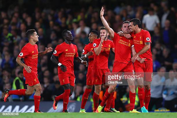Jordan Henderson of Liverpool celebrates scoring his sides second goal with team mates during the Premier League match between Chelsea and Liverpool...