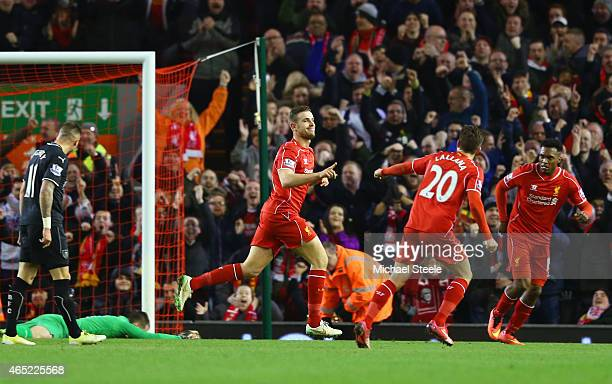 Jordan Henderson of Liverpool celebrates scoring the opening goal during the Barclays Premier League match between Liverpool and Burnley at Anfield...