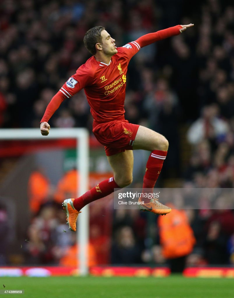 Jordan Henderson of Liverpool celebrates scoring the second goal during the Barclays Premier League match between Liverpool and Swansea City at Anfield on February 23, 2014 in Liverpool, England.