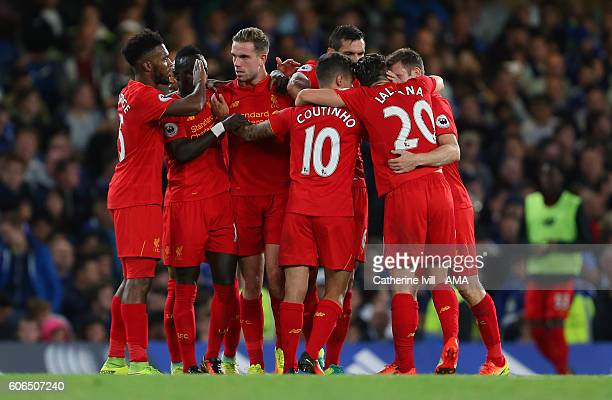Jordan Henderson of Liverpool celebrates with his team mates after he scores to make it 02 during the Premier League match between Chelsea and...