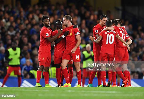 Jordan Henderson of Liverpool celebrates with team mates as he scores their second goal during the Premier League match between Chelsea and Liverpool...