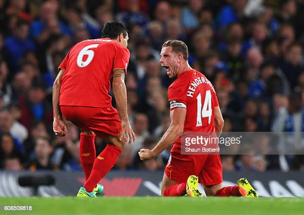 Jordan Henderson of Liverpool celebrates with team mates Dejan Lovren as he scores their second goal during the Premier League match between Chelsea...