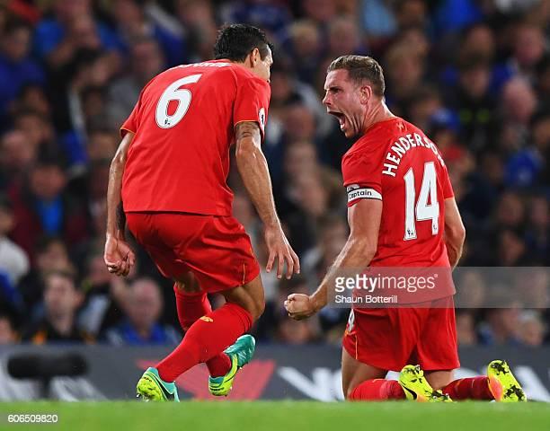 Jordan Henderson of Liverpool celebrates with team mates Dejan Lovren as he scores their second goal during the Premier League match between Chelsea...