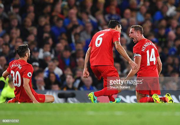 Jordan Henderson of Liverpool celebrates with team mates Dejan Lovren and Adam Lallana as he scores their second goal during the Premier League match...