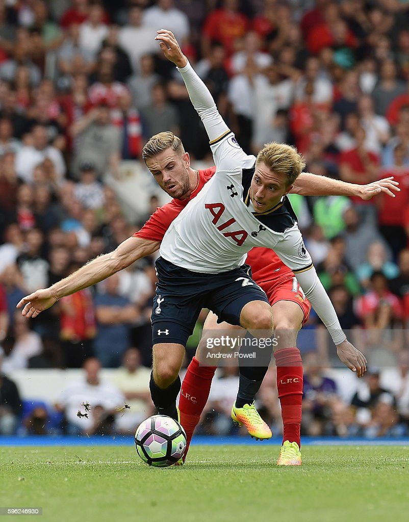 Jordan Henderson of Liverpool competes with Christian Eriksen of Tottenham Hotspur during the Premier League match between Tottenham Hotspur and Liverpool at White Hart Lane on August 27, 2016 in London, England.