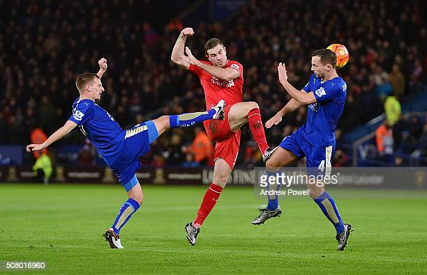 Jordan Henderson of Liverpool competes with Marc Albrighton and Daniel Drinkwater of Leicester City during the Barclays Premier League match between...