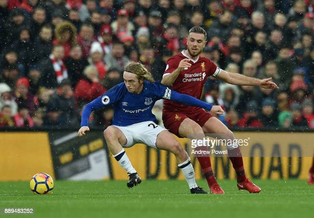Jordan Henderson of Liverpool competes with Tom Davies of Everton during the Premier League match between Liverpool and Everton at Anfield on...