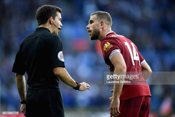 Jordan Henderson of Liverpool complaines to the linesman after Leicester City score their first goal during the Premier League match between...