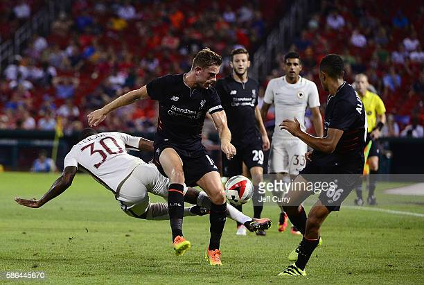 Jordan Henderson of Liverpool FC and Da Silva Gerson of AS Roma battle for the ball during a friendly match at Busch Stadium on August 1 2016 in St...