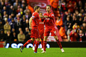 Jordan Henderson of Liverpool hands the captain's armband over to Steven Gerrard of Liverpool as he comes on to the field during the Barclays Premier...