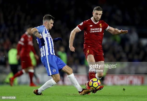 Jordan Henderson of Liverpool is challenged by Pascal Gross of Brighton and Hove Albion during the Premier League match between Brighton and Hove...