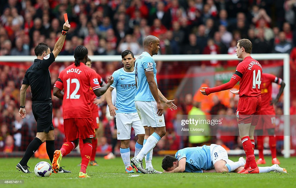 <a gi-track='captionPersonalityLinkClicked' href=/galleries/search?phrase=Jordan+Henderson&family=editorial&specificpeople=4940390 ng-click='$event.stopPropagation()'>Jordan Henderson</a> of Liverpool is shown a red card by Referee <a gi-track='captionPersonalityLinkClicked' href=/galleries/search?phrase=Mark+Clattenburg&family=editorial&specificpeople=2108870 ng-click='$event.stopPropagation()'>Mark Clattenburg</a> during the Barclays Premier League match between Liverpool and Manchester City at Anfield on April 13, 2014 in Liverpool, England.